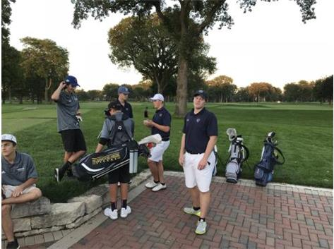 Shane Rollins and Michael Hilgart review their scores with their co-competitors after their match at Oak Park Country Club.  Thomas Hilgart awaits the results