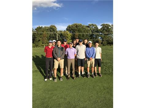 Mark Wilson, taking a picture with the Knights golf team after the clinic