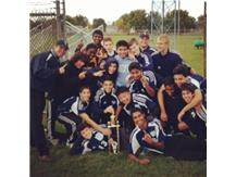 An excited group of players; JV Soccer Champions!