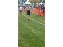 Senior Daniel Chen finishing 1st with a time of 15:13 at the Kaneland cross country sectional.