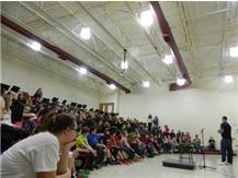 Johnsburg Alum and current Houston Texan CJ Fiedorowicz talks to Johnsburg Junior High Students.