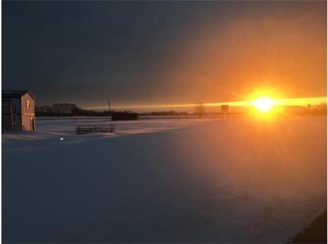 Sunrise over the soccer field.