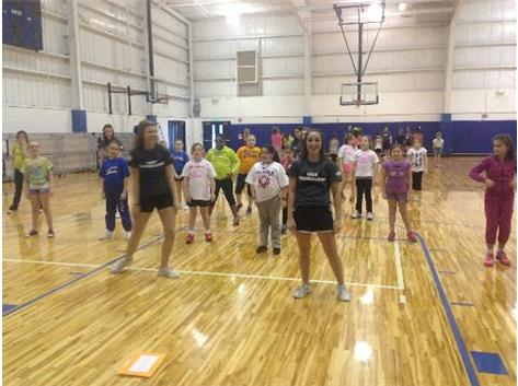 Limestone Cheer working with the 3rd and 4th graders at the Winter Cheer Clinic.