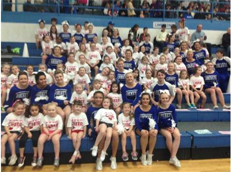LCHS Cheer hanging out with their campers during the game!