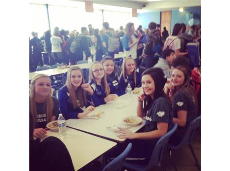 Freshman cheerleaders enjoying their very first Food Fair.