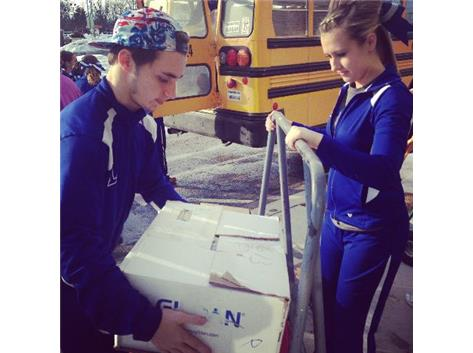 Junior Cole Huffman and Senior Sara Stear load up items for the Washington Tornado Victims.