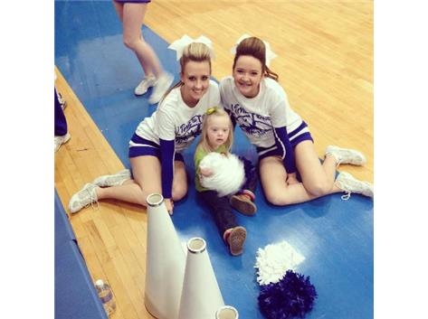 Senior Sara Stear and Freshman Kelly Bredernitz hang out with Maggie before the White Out game.