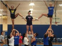 JV and Varsity practicing pyramid for assembly.