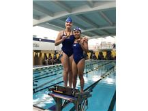 Jessica Domian and Rianca Argenal place 1st in the Freshman 100 Fly Relay!