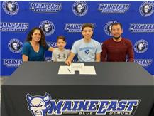 Sr. Jeff Becerra and family signing his letter of intent to Elmhurst College.