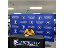 Ramy signing his letter of intent to play soccer at Western Illinois.