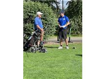 Coach Burda giving some directions to one of his golfers at the 2021 Leyden Invite