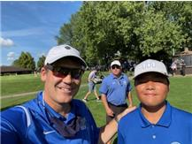 Coach Miller and ME golfer at the 2021 Leyden Invite.