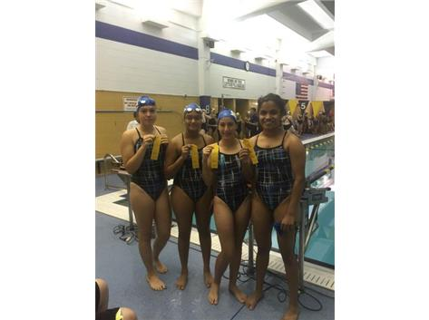 SmurtiAmin, Lauren Lozneanu , Racheal Koshy , Annette Mikolajczyk finishing fourth in the 200 Yard Medley Relay.