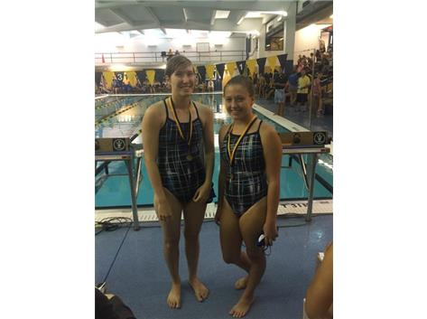 Sophia Learnahan and Simone Welt finishing First in the 100Yard Fly Relay.