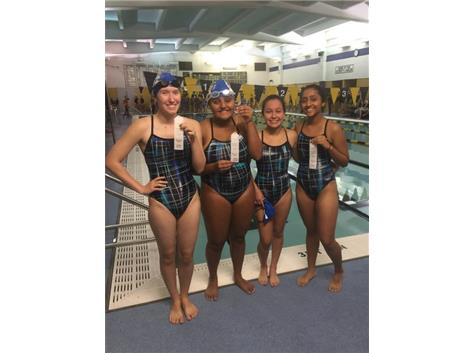 Jessica Espinoza, Simone Welt, Jiral Modi, and Krina Shah finishing third in the 200 Yard Free Relay.