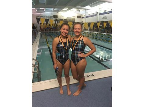 Sophia Learnahan, and Jessica Espinoza Finishing second in the 100 Yard Back Relay.