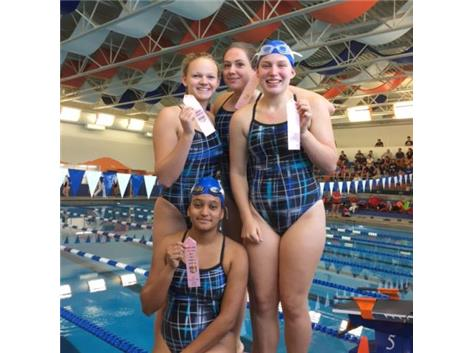 Annette Mikolajczyk, Smruti Amin, Rachel Schaefges, and Alyssa Klug finishing 6th in the 400 Freestyle relay at the Hoffman Invite