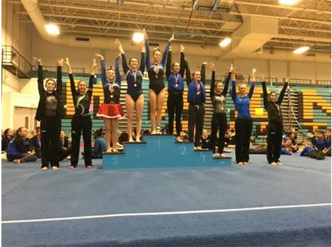 Afroditi Balltsas - 6th Place, Giselle Mendoza - 9th Place, Elizabeth Urban - 10th Place, Varsity Uneven Bars at Maine West Invite