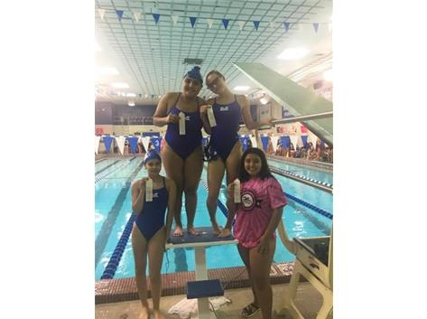 Jiral Modi, Maggie Musiejuk, Ariel  Aguilera, and Damaris Tellez place 3rd in the 200 Yard Butterfly Relay!