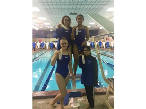 Maggie Musiejuk, Krina Shah, Nives Ramich, and Ariel Aguilera placed 3rd in the JV 400 yard Freestyle Relay!