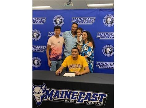 Ramy and his family at his signing day event!