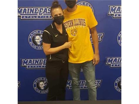 Ramy and ME head athletic trainer, Megan Luetje at his signing day event.