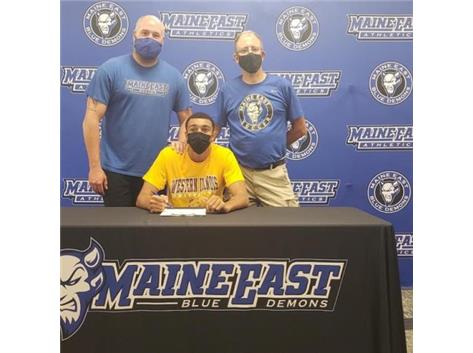 Ramy and his coaches at his signing day. We are so proud of you Ramy!