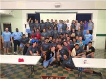 Varsity Football team volunteered  at Bessie's Table of Des Plaines