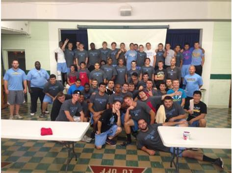 Varsity Football team volunteered  at Bessie's Table of Des Plaines