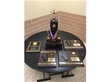 The softball awards displayed at reception for Marist State Softball Champs include plaques for ESCC 1st Place, IHSA Regional, IHSA Sectional, IHSA Super Sectional and the IHSA Class 4A State Championship Trophy.