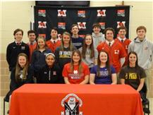 PHOTO: Marist seniors signed to continue their academic and athletic careers at the collegiate level at a ceremony April 13. They are (seated from left) Maggie Murphy, Alexis Jones, Madeline McHugh, Emily Reilly, Paige Egan (second row) Kyle O'Farrell, Haley Belcik, Amanda McIlhany, Gabby Moran, Ben Chaffee, Aaron Kummer, (third row) Zach Sefcik, Jack Snyder, Patrick Bradford, Michael Burcl, and John Carmody.