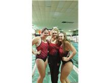 Swimming Seniors (l to r)Megan Costello, Ellen Przepiora and Leah Hood pose during last meet of senior season