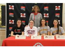 National Signing Day 2016 Coach Connolly with Claire Austin (Davenport University), Caily Landers (St. Mary's), Kate Ruzevich (Quincy) and Julia Ruzevich (Quincy) Sign letters of intent to continue their basketball carrers in college