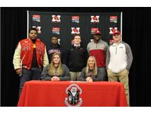 Marist student athletes sign NLI to continue their academic and athletic careers in college. Seated l to r Jenna Ford lacrosse (Aurora)Taylor Nesbitt (Concordia). Standing l to r ; Football signees - Elijah Teague (Indiana) Delonte Harrel (Cornell) Michael Lawlor (University of Chicago)Turon Ivy (Indiana)Gavin McCabe (Indiana)