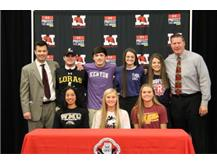 Marist student athletes sign NLI to continue their academic and athletic careers in college. Seated l to r:Maggie Kehoe softball (Western Michigan) Kara Apato softball (Northern Illinois), Savannah Thompson volleyball Central Michigan). Standing l to r AD Eric Simpson, Jason Trbovic baseball (Loras)Jack Anderson baseball (Kenyon College)Molly Murrihy volleyball (Memphis) Grace Green volleyball (Radford)