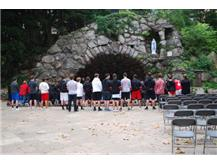 RedHawks Hockey prayer at the Grotto