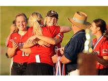 Coach Bromberek hugs Brooke Wyderski to celebrate the first State Championship in any Girls' athletic program!