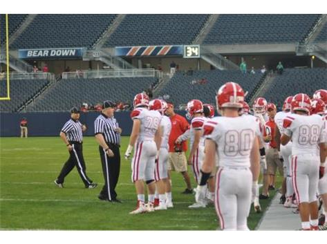Officials discussion on Soldier Field sideline