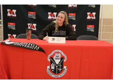 Senior Maddie Dunterman signs Letter of Intent to continue her academic and volleyball career at Lehigh University on November 9, 2016