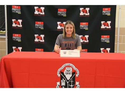 Alexis Rogers with Coach Biebel signs Letter of Intent to continue her academic and softball career at University of Tennessee-Martin on November 9, 2016.