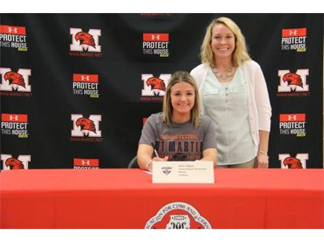 Alexis Rogers (University of Tennessee-Martin) and Coach Biebel on National Signing Day. November 9, 2016