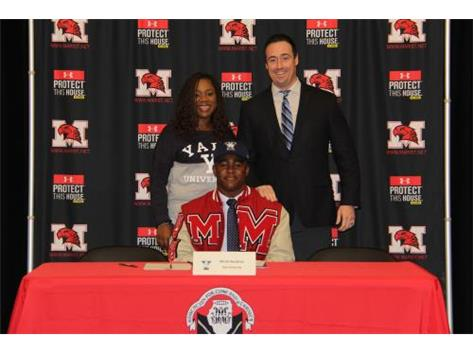 Micah Awodiran with family and Coach Dunne signing with Yale football