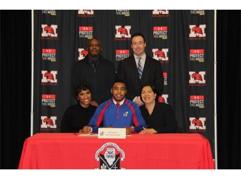 NSD 2017 Rob Topps III with family and Coach Dunne signing with Kansas University football.