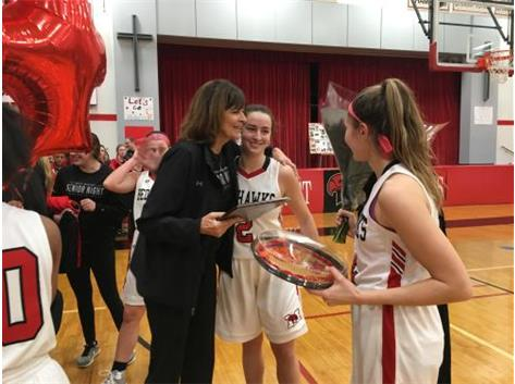 Seniors present Coach Connolly with gift marking her 400th win