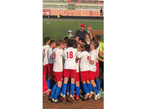 Varsity soccer celebrates the 3-2 victory over Brother Rice September 7, 2019 to win Pulaski Cup