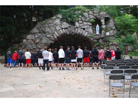 RedHawks Hockey prayer at the Grotto