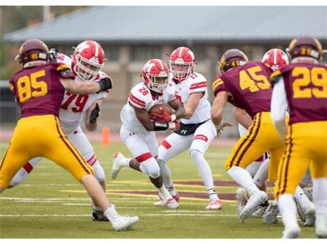Mikesell hands off to Watkins as RedHawks run the ball in 14-6 victory at Loyola on October 26, 2019.