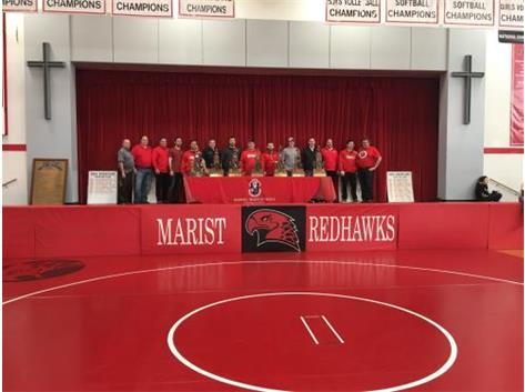 Marist wrestling alumni proudly display IHSA State trophy;s during Marist Mega Duals on December 15, 2018