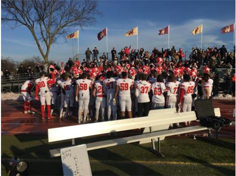 Varsity football players salute fans with the Marist Fight Song after defeating Loyola 41-27 in the Class 8A Quarter Finals November 16, 2019